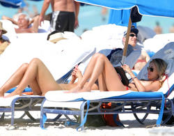 http://img275.imagevenue.com/loc35/th_260217802_lauren_stoner_bikini_topless_march19_2012_40_123_35lo.jpg