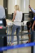 Dakota Fanning - LAX AIrport Candids 05/06/14